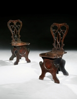 An Unusual Pair of George III Period Mahogany Hall Chairs