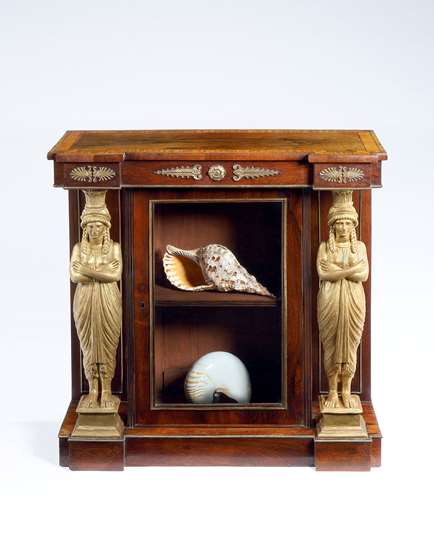 A rare Regency Period Rosewood Satinwood and Carved Giltwood Side Cabinet
