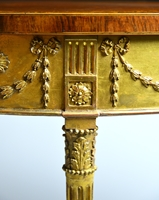 A George III Satinwood Marquetry Giltwood and Composition Demi-Line Side Table