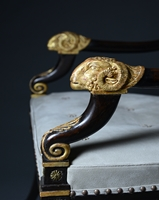 A rare Pair of Regency Ebonised and Parcel Gilt Armchairs Attributed to Morel and Hughes