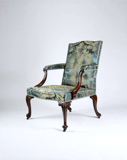 A Rare George III Carved Mahogany 'Gainsborough' Armchair attributed to Paul Saunders
