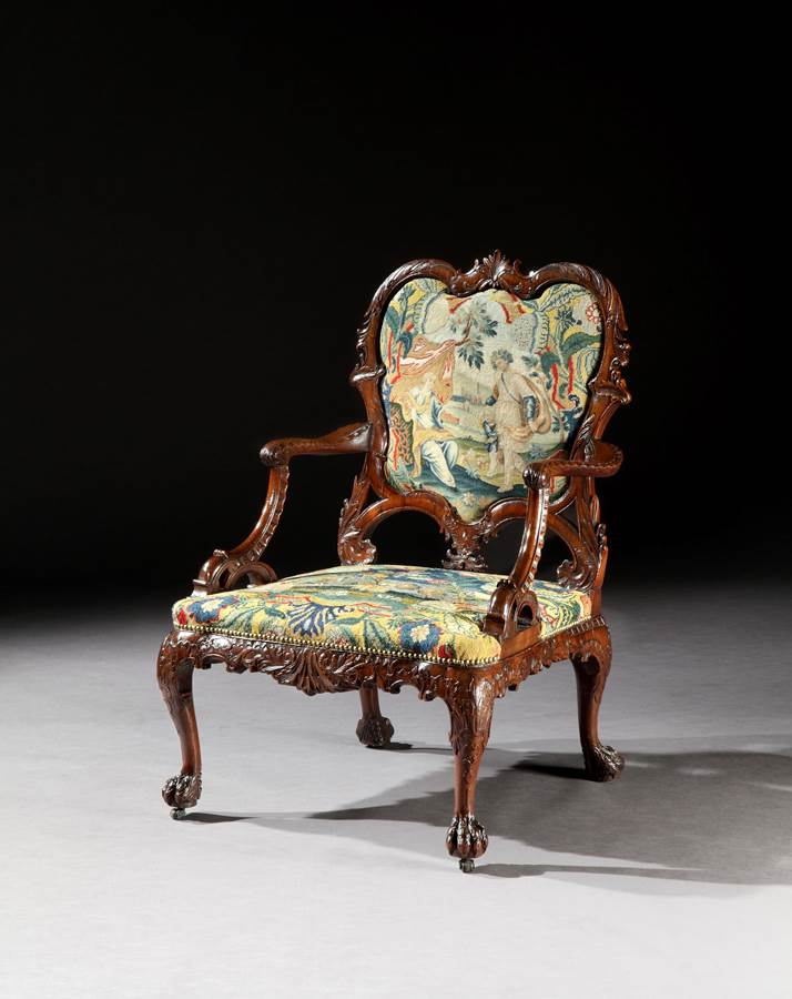 A rare George II period carved mahogany armchair after a design by Thomas Chippendale English