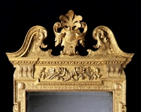 A Rare George II Carved Giltwood Mirror