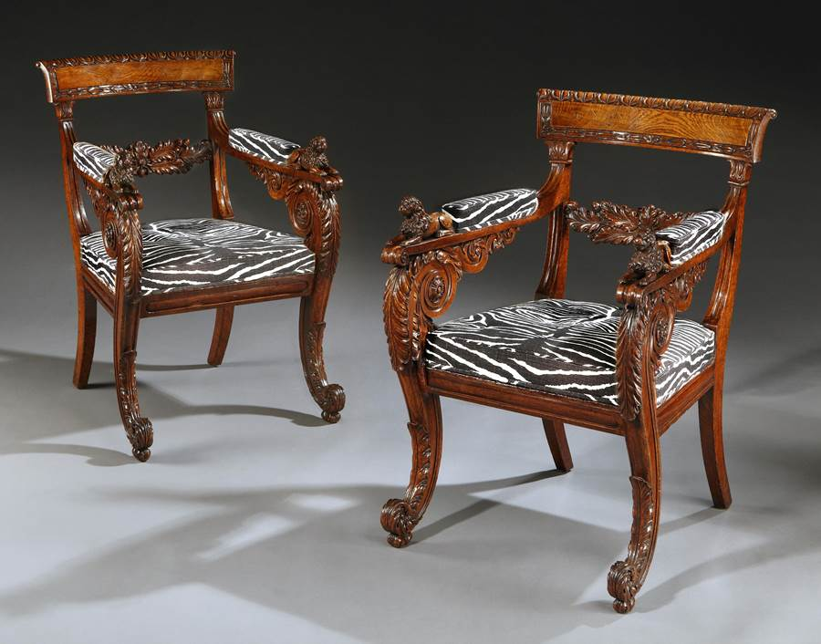 An outstanding pair of Regency period carved oak armchairs