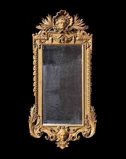 A rare George II giltwood architectural mirror