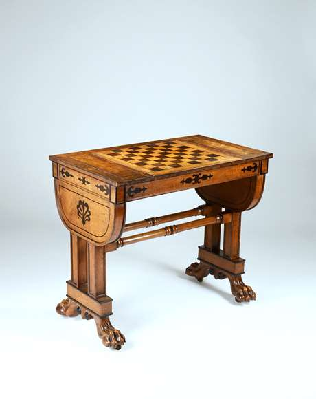 An Exceptional Regency Period Games Table in Solid and Veneered Lacewood Inlaid with Ebony to a Design by George Smith