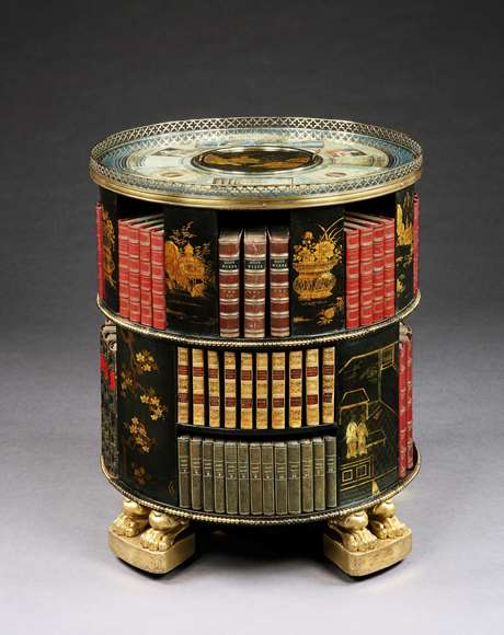 A rare Regency period painted and gilded circular bookcase with Chinese lacquer panels