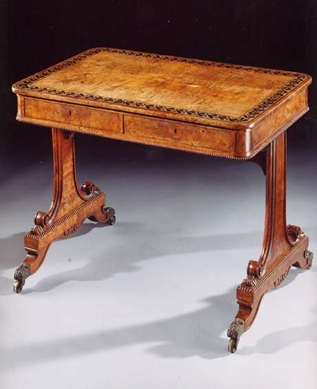 A Regency period ebony-inlaid pollard oak writing table of wonderful untouched colour and patination